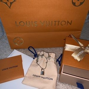 Authentic Louis Vuitton silver lockit pendant